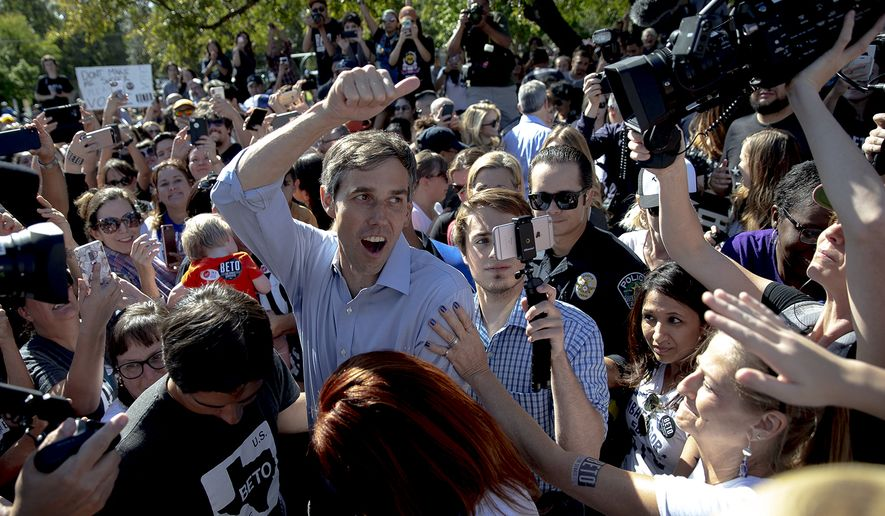 Beto O'Rourke, the 2018 Democratic candidate for U.S. Senate in Texas, greets supporters following a rally at the Pan American Neighborhood Park in Austin, Texas, on Sunday, Nov. 4, 2018. (Nick Wagner/Austin American-Statesman via AP)