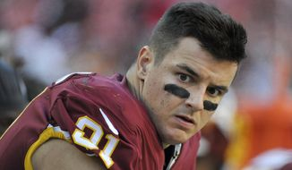 Washington Redskins outside linebacker Ryan Kerrigan (91) sits on the bench during the second half of an NFL football game between the Atlanta Falcons and the Washington Redskins, Sunday, Nov. 4, 2018 in Landover, Md. The Falcons defeated the Redskins 38-14. (AP Photo/Mark Tenally) ** FILE **