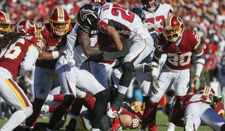 Atlanta Falcons running back Ito Smith (25) leaps toward the end zone for a touchdown during the first half of an NFL football game against the Washington Redskins, Sunday, Nov. 4, 2018, in Landover, Md. (AP Photo/Pablo Martinez Monsivais)