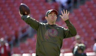 Washington Redskins quarterback Colt McCoy warms up prior to an NFL football game against the Atlanta Falcons, Sunday, Nov. 4, 2018, in Landover, Md. (AP Photo/Mark Tenally)