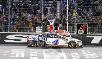 Kevin Harvick celebrates with fans after winning a NASCAR Cup auto race at Texas Motor Speedway, Sunday, Nov. 4, 2018, in Fort Worth, Texas. (AP Photo/Larry Papke) **FILE**