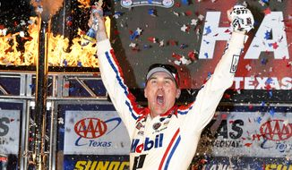 Kevin Harvick celebrates after winning a NASCAR Cup auto race in Victory Lane at Texas Motor Speedway, Sunday, Nov. 4, 2018, in Fort Worth, Texas. (AP Photo/Larry Papke)