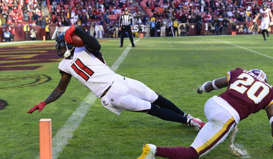 Atlanta Falcons wide receiver Julio Jones (11) dives past Washington Redskins free safety Ha Ha Clinton-Dix (20) and into the end zone for a touchdown during the second half of an NFL football game, Sunday, Nov. 4, 2018, in Landover, Md. (AP Photo/Susan Walsh)