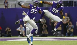 Minnesota Vikings defensive end Danielle Hunter (99) celebrates with teammate Everson Griffen (97) after sacking Detroit Lions quarterback Matthew Stafford during the first half of an NFL football game, Sunday, Nov. 4, 2018, in Minneapolis. (AP Photo/Jim Mone)