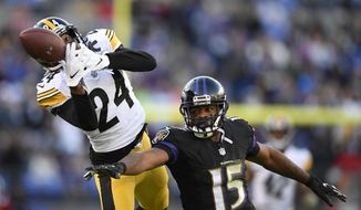 Pittsburgh Steelers cornerback Coty Sensabaugh, left, breaks up a pass-attempt to Baltimore Ravens wide receiver Michael Crabtree in the second half of an NFL football game, Sunday, Nov. 4, 2018, in Baltimore. (AP Photo/Nick Wass)