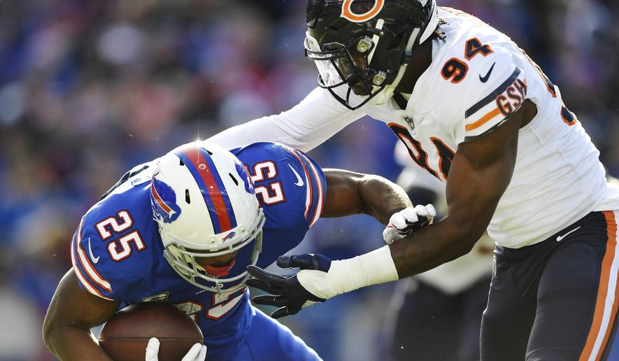 Chicago Bears' Leonard Floyd (94) tackles Buffalo Bills' LeSean McCoy (25) during the first half of an NFL football game Sunday, Nov. 4, 2018, in Orchard Park, N.Y. (AP Photo/Adrian Kraus)