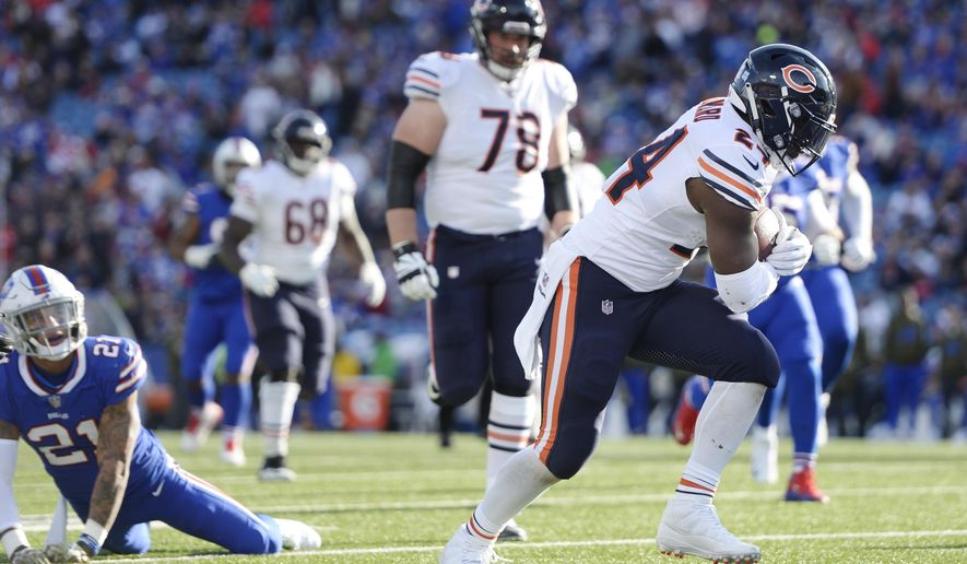 Chicago Bears running back Jordan Howard (24) rushes past Buffalo Bills free safety Jordan Poyer (21) to score a touchdown during the first half of an NFL football game Sunday, Nov. 4, 2018, in Orchard Park, N.Y. (AP Photo/Adrian Kraus)