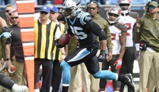Carolina Panthers' Eric Reid (25) returns an interception against the Tampa Bay Buccaneers in the first half of an NFL football game in Charlotte, N.C., Sunday, Nov. 4, 2018. (AP Photo/Mike McCarn) ** FILE **