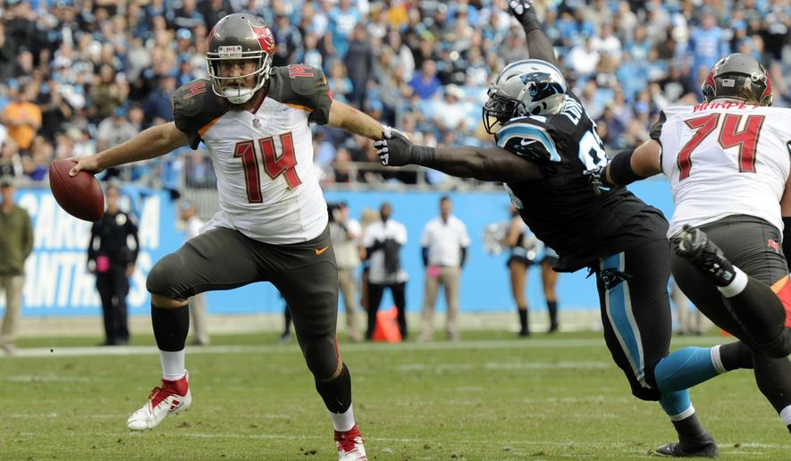 Tampa Bay Buccaneers' Ryan Fitzpatrick (14) runs past Carolina Panthers' Kyle Love (93) in the first half of an NFL football game in Charlotte, N.C., Sunday, Nov. 4, 2018. (AP Photo/Mike McCarn)