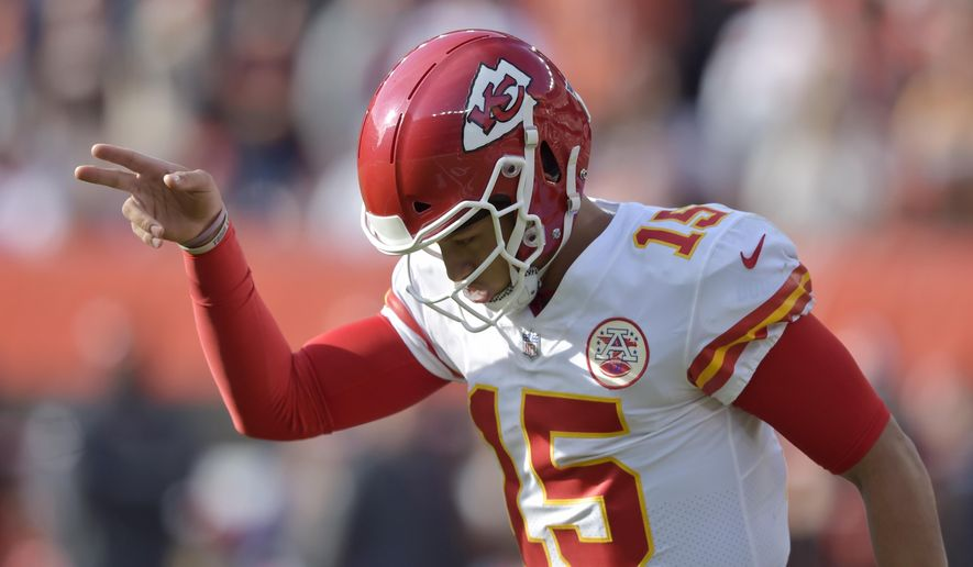 Kansas City Chiefs quarterback Patrick Mahomes celebrates a 1-yard touchdown by running back Kareem Hunt during the first half of an NFL football game against the Cleveland Browns, Sunday, Nov. 4, 2018, in Cleveland. (AP Photo/David Richard)