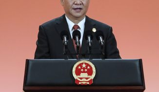 """In this photo released by China's Xinhua News Agency, Chinese President Xi Jinping addresses a banquet on the eve of the China International Import Expo in Shanghai, Sunday, Nov. 4, 2018. Facing a blizzard of trade complaints, China is throwing an """"open for business"""" import fair hosted by President Xi Jinping to rebrand itself as a welcoming market and positive global force. (Xie Huanchi/Xinhua via AP)"""