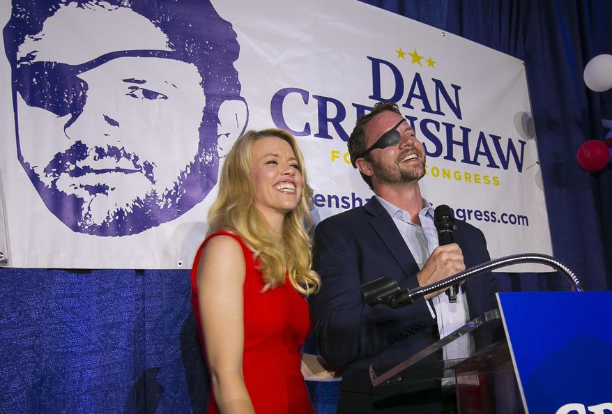 In this Tuesday, May 22, 2018, file photo, Republican congressional candidate Dan Crenshaw reacts to the crowd with his wife, Tara, as he comes on stage to deliver a victory speech during an election night party at the Cadillac Bar, in Houston. (Mark Mulligan/Houston Chronicle via AP) **FILE**