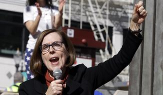 FILE In this Oct. 17, 2018 file photo, Oregon Gov. Kate Brown speaks during a rally in Portland, Ore. Brown is facing a challenge from Republican Knute Buehler, a state lawmaker who describes himself as a moderate and who has been wooing the party faithful, soft-right Democrats, and unaffiliated voters. (AP Photo/Don Ryan, File)