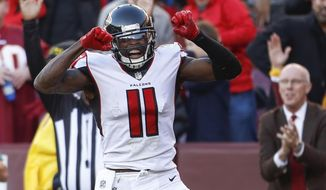 Atlanta Falcons wide receiver Julio Jones (11) celebrates his touchdown during the second half of an NFL football game between against the Washington Redskins, Sunday, Nov. 4, 2018, in Landover, Md. (AP Photo/Pablo Martinez Monsivais)
