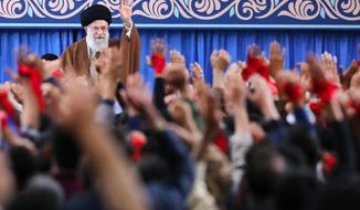 """In this picture released by an official website of the office of the Iranian supreme leader, Supreme Leader Ayatollah Ali Khamenei waves to the crowd during a meeting in Tehran, Iran, Saturday, Nov. 3, 2018. Khamenei says on the eve of the anniversary of the 1979 takeover of the U.S. Embassy in Tehran that the Islamic Republic is the """"victorious party"""" after nearly 40 years of confrontation by the U.S. (Office of the Iranian Supreme Leader via AP)"""