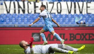 Lazio's Ciro Immobile celebrates after scoring his side's 2nd goal during the Serie A soccer match between Lazio and Spal at the Olympic stadium in Rome, Sunday, Nov. 4, 2018. (Angelo Carconi/ANSA via AP)