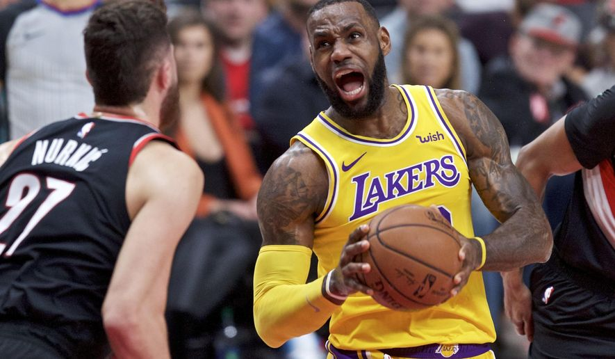 Los Angeles Lakers forward LeBron James, right, drives to the basket towards Portland Trail Blazers center Jusuf Nurkic during the first half of an NBA basketball game in Portland, Ore., Saturday, Nov. 3, 2018. (AP Photo/Craig Mitchelldyer)