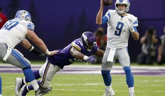 Detroit Lions quarterback Matthew Stafford (9) is sacked by Minnesota Vikings defensive tackle Tom Johnson during the second half of an NFL football game, Sunday, Nov. 4, 2018, in Minneapolis. (AP Photo/Jim Mone)