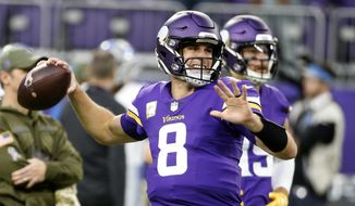 Minnesota Vikings quarterback Kirk Cousins warms up before an NFL football game against the Detroit Lions, Sunday, Nov. 4, 2018, in Minneapolis. (AP Photo/Bruce Kluckhohn) ** FILE **