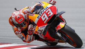 Honda rider Marc Marquez of Spain powers his bike during the Malaysia MotoGP at the Sepang International Circuit in Sepang, Malaysia, Sunday, Nov. 4, 2018. (AP Photo/Vincent Thian)