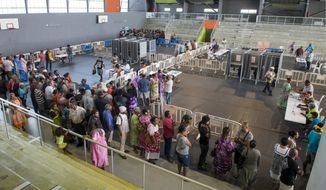 Residents of New Caledonia's capital, Noumea, wait in line at a polling station dedicated to the natives of the Loyalty islands, before casting their vote as part of an independence referendum, Sunday, Nov. 4, 2018. Voters in New Caledonia are deciding whether the French territory in the South Pacific should break free from the European country that claimed it in the mid-19th century. (AP Photo/Mathurin Derel) ** FILE **