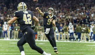 New Orleans Saints quarterback Drew Brees (9) throws a pass to teammate Zach Line during an NFL football game against the Los Angeles Rams, Sunday, Nov. 4, 2018, in New Orleans. (Scott Clause/The Daily Advertiser via AP)