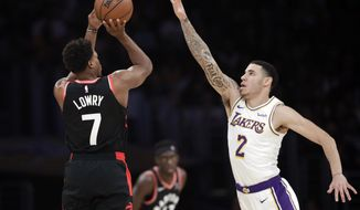 Toronto Raptors' Kyle Lowry (7) shoots over Los Angeles Lakers' Lonzo Ball (2) during the first half of an NBA basketball game Sunday, Nov. 4, 2018, in Los Angeles. (AP Photo/Marcio Jose Sanchez)