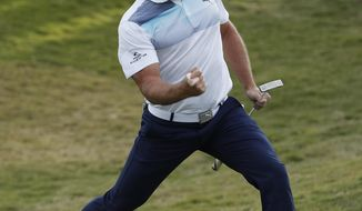 Bryson DeChambeau celebrates after sinking a putt for an eagle on the 16th green during the final round of the Shriners Hospitals for Children Open golf tournament Sunday, Nov. 4, 2018, in Las Vegas. (AP Photo/John Locher)