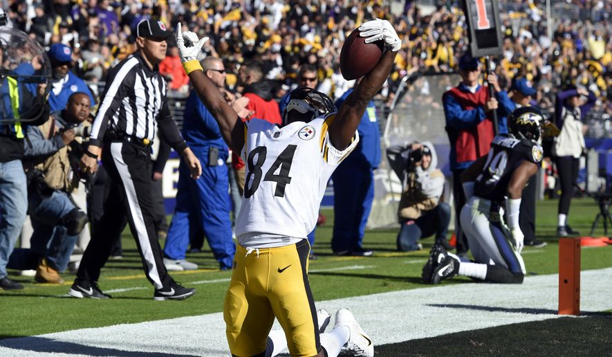 Pittsburgh Steelers wide receiver Antonio Brown celebrates after scoring a touchdown in the first half of an NFL football game against the Baltimore Ravens, Sunday, Nov. 4, 2018, in Baltimore. (AP Photo/Gail Burton)