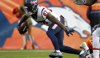 Houston Texans wide receiver Demaryius Thomas (87) runs after the catch during the first half of an NFL football game against the Denver Broncos, Sunday, Nov. 4, 2018, in Denver. (AP Photo/Jack Dempsey)