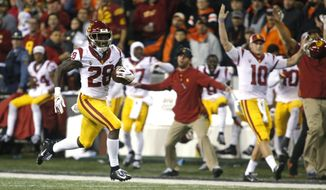 Southern California' Aca'Cedric Ware (28) races past his bench on a 57-yard touchdown run in the first half of an NCAA college football game against Oregon State in Corvallis, Ore., on Saturday, Nov. 3, 2018. (AP Photo/Timothy J. Gonzalez)