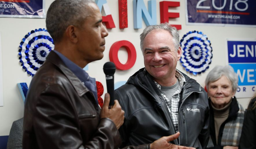Sen. Tim Kaine, D-Va., right, smiles as former President Barack Obama speaks to Democratic volunteers during a surprise stop in Fairfax Station, Va., on Monday, Nov. 5, 2018. (AP Photo/Jacquelyn Martin)
