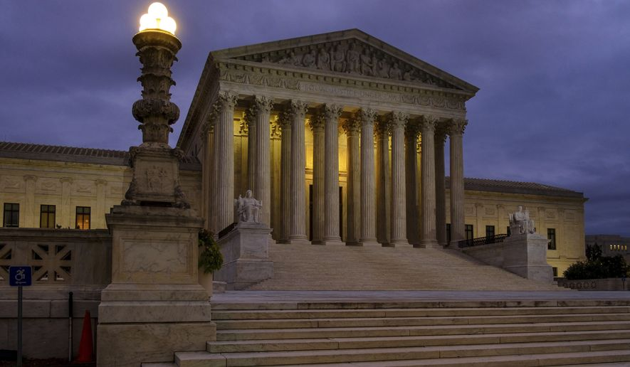 The U. S. Supreme Court building stands quietly before dawn in Washington, Friday, Oct. 5, 2018. The U.S. Senate will start the process of voting on Brett Kavanaugh's confirmation as a Supreme Court Associate Justice today. (AP Photo/J. David Ake)