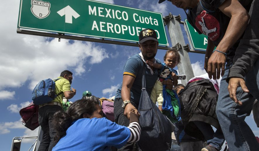 U.S.-bound Central American migrants get on to a truck for a a free ride, as part of a thousands-strong caravan moving through Puebla, Mexico, Monday, Nov. 5, 2018. A big group of Central Americans pushed on toward Mexico City from a coastal state Monday, planning to exit a part of the country that has long been treacherous for migrants seeking to get to the United States. (AP Photo/Rodrigo Abd)