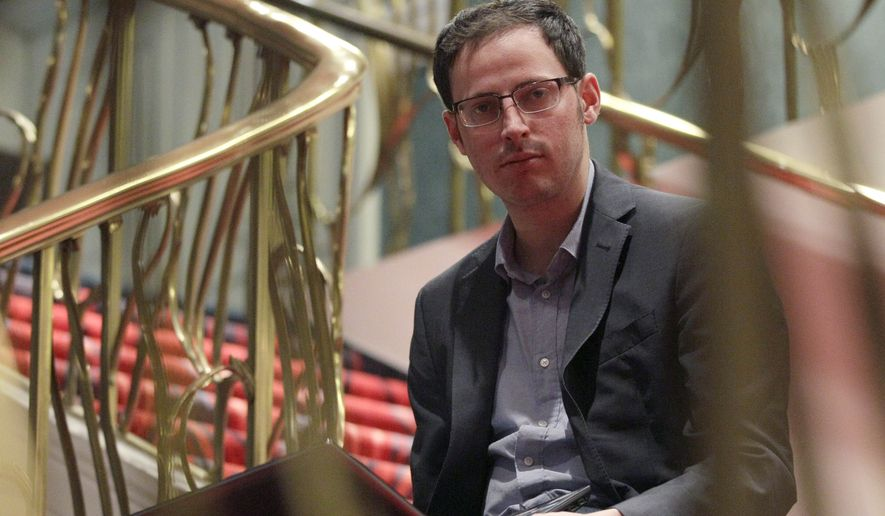 Nate Silver sits on the stairs at Allegro hotel in downtown Chicago, Friday, Nov. 9, 2012. The 34-year-old statistician, unabashed numbers geek, author and creator of the much-read FiveThirtyEight blog at The New York Times, correctly predicted the presidential winner in all 50 states, and almost all the Senate races. (AP Photo/Nam Y. Huh)