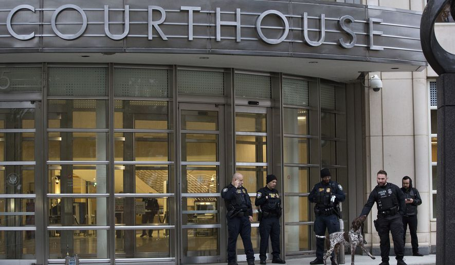 """The Department of Homeland Security has personnel in place in front of the Brooklyn Federal Courthouse for the start of jury selection in the trial of Joaquin """"El Chapo"""" Guzman, Monday, Nov. 5, 2018, in New York. Guzman was extradited to the United States last year on charges he spent decades commanding the Sinaloa cartel's drug wars, consolidating the market abroad while expanding his empire in Mexico. (AP Photo/Mark Lennihan)"""