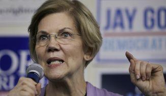 Democrat U.S. Sen. Elizabeth Warren addresses a crowd during a campaign stop Monday, Nov. 5, 2018, in Lynn, Mass. Republican Geoff Diehl is challenging Warren in the November general election. (AP Photo/Steven Senne)