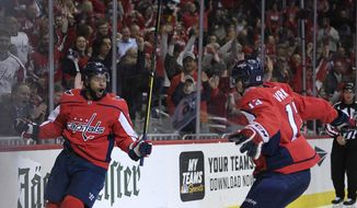 Washington Capitals right wing Devante Smith-Pelly, left,  celebrates his goal with Washington Capitals left wing Jakub Vrana, right,  of the Czech Republic, during the first period of an NHL hockey game against the Edmonton Oilers, Monday, Nov. 5, 2018, in Washington. (AP Photo/Nick Wass)