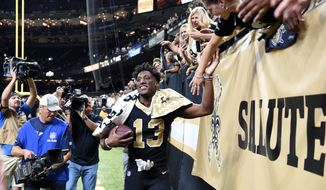 New Orleans Saints wide receiver Michael Thomas (13) greets fans after an NFL football game against the Los Angeles Rams in New Orleans, Sunday, Nov. 4, 2018. The Saints won 45-35. (AP Photo/Bill Feig)