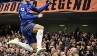 Chelsea's Alvaro Morata celebrates after scoring the opening goal during the English Premier League soccer match between Chelsea and Crystal Palace at Stamford Bridge stadium in London, Sunday, Nov. 4, 2018. (AP Photo/Frank Augstein)