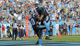 Carolina Panthers' Curtis Samuel (10) and Cam Newton (1) celebrates their touchdown against the Tampa Bay Buccaneers in the second half of an NFL football game in Charlotte, N.C., Sunday, Nov. 4, 2018. (AP Photo/Mike McCarn)