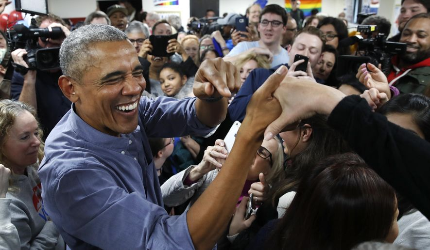 Former President Barack Obama smiles as he greets Democratic volunteers in a surprise appearance in Fairfax Station, Va., on Monday, Nov. 5, 2018. (AP Photo/Jacquelyn Martin)