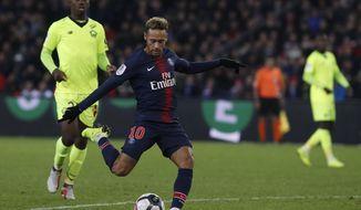 PSG's Neymar, center, shots to score his side second goal during the League One soccer match between Paris Saint-Germain and Lille at the Parc des Princes stadium in Paris, Friday, Nov. 2, 2018. (AP Photo/Thibault Camus)