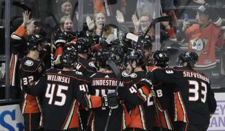 The Anaheim Ducks players celebrate the team's 3-2 overtime win against the Columbus Blue Jackets in an NHL hockey game against the Columbus Blue Jackets Sunday, Nov. 4, 2018, in Anaheim, Calif. (AP Photo/Jae C. Hong)