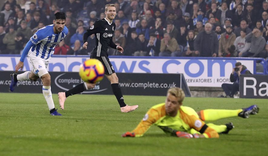 Fulham's Andre Schurrle shoots wide during their English Premier League soccer match against Huddersfield Town at The John Smith's Stadium, Huddersfield, England, Monday, Nov. 5, 2018. (Martin Rickett/PA via AP)