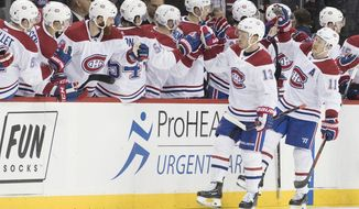 Montreal Canadiens left wing Max Domi (13) celebrates after scoring a goal in the second period of an NHL hockey game against the New York Islanders, Monday, Nov. 5, 2018, in New York. (AP Photo/Mary Altaffer)