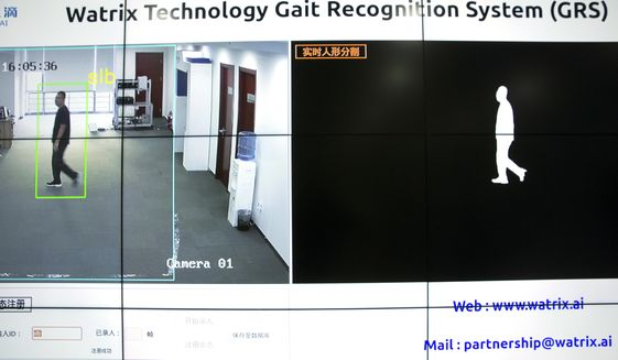 """In this Oct. 31, 2018, file photo, a screen displays images of a Watrix employee walking during a demonstration of their firm's gait recognition software at their company's offices in Beijing. A Chinese technology startup hopes to begin selling software that recognizes people by their body shape and how they walk, enabling identification when faces are hidden from cameras. Already used by police on the streets of Beijing and Shanghai, """"gait recognition"""" is part of a major push to develop artificial-intelligence and data-driven surveillance across China, raising concern about how far the technology will go. (AP Photo/Mark Schiefelbein)"""