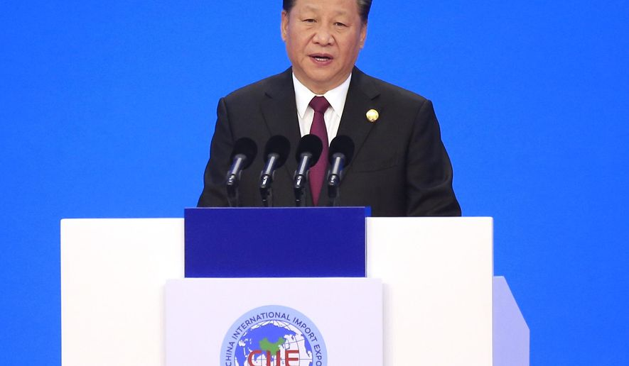 Chinese President Xi Jinping speaks at the opening ceremony for the China International Import Expo in Shanghai, Monday, Nov. 5, 2018. Xi promised Monday to open China wider to imports at the start of a high-profile trade fair meant to rebrand the country as a global customer but offered no response to U.S. and European complaints about technology policy and curbs on foreign business. (Aly Song/Pool Photo via AP)