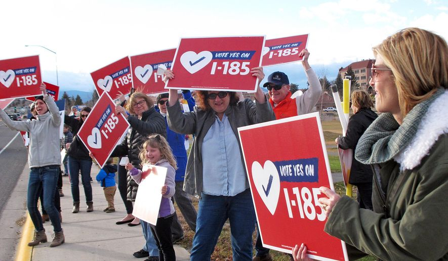 This Monday, Nov. 5, 2018, photo shows supporters of a Montana ballot initiative to extend the state's Medicaid expansion program and raise tobacco taxes rally in Helena, Mont. (AP Photo/Matt Volz)
