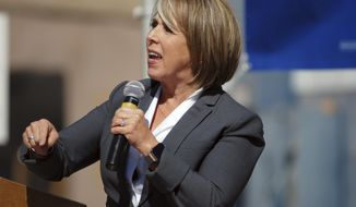 In this Thursday, Oct. 25, 2018 photo, New Mexico gubernatorial candidate and U.S. Rep. Michelle Lujan Grisham speaks to an audience including many unionized state workers in Santa Fe, N.M. Grisham is competing against Republican U.S. Rep. Steve Pearce of Hobbs. Republican Gov. Susana Martinez cannot run for a consecutive third term. (AP Photo/Morgan Lee)
